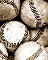 THIS is a baseball: actually eight (two peek thro) well-used balls, undoubtedly from a bygone era.